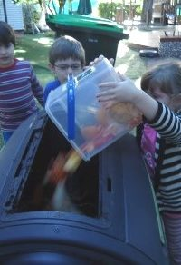 Emptying the fruit scraps into the worm farm or compost bin is part of our routine.